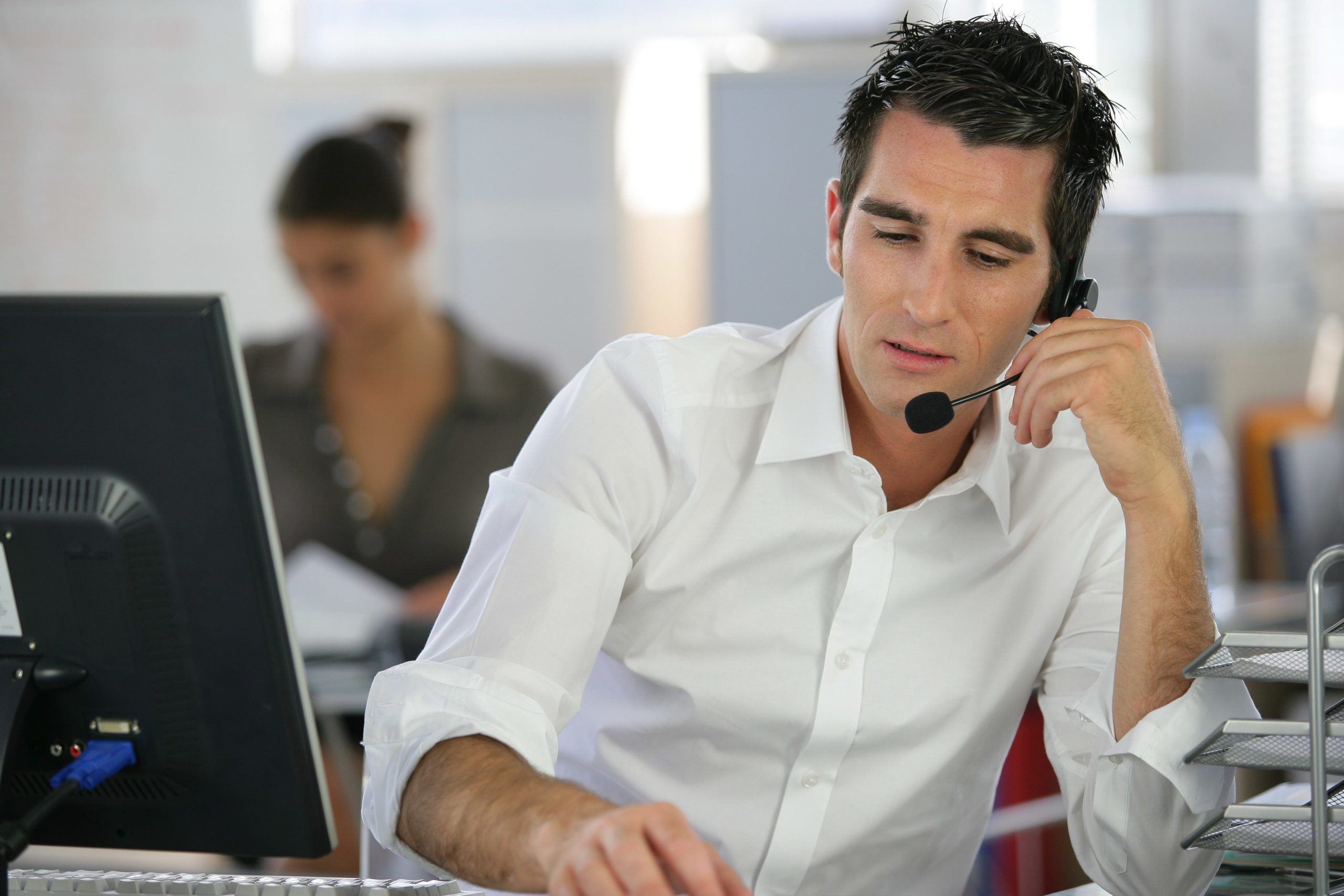 Call centre agent providing customer support over the phone.