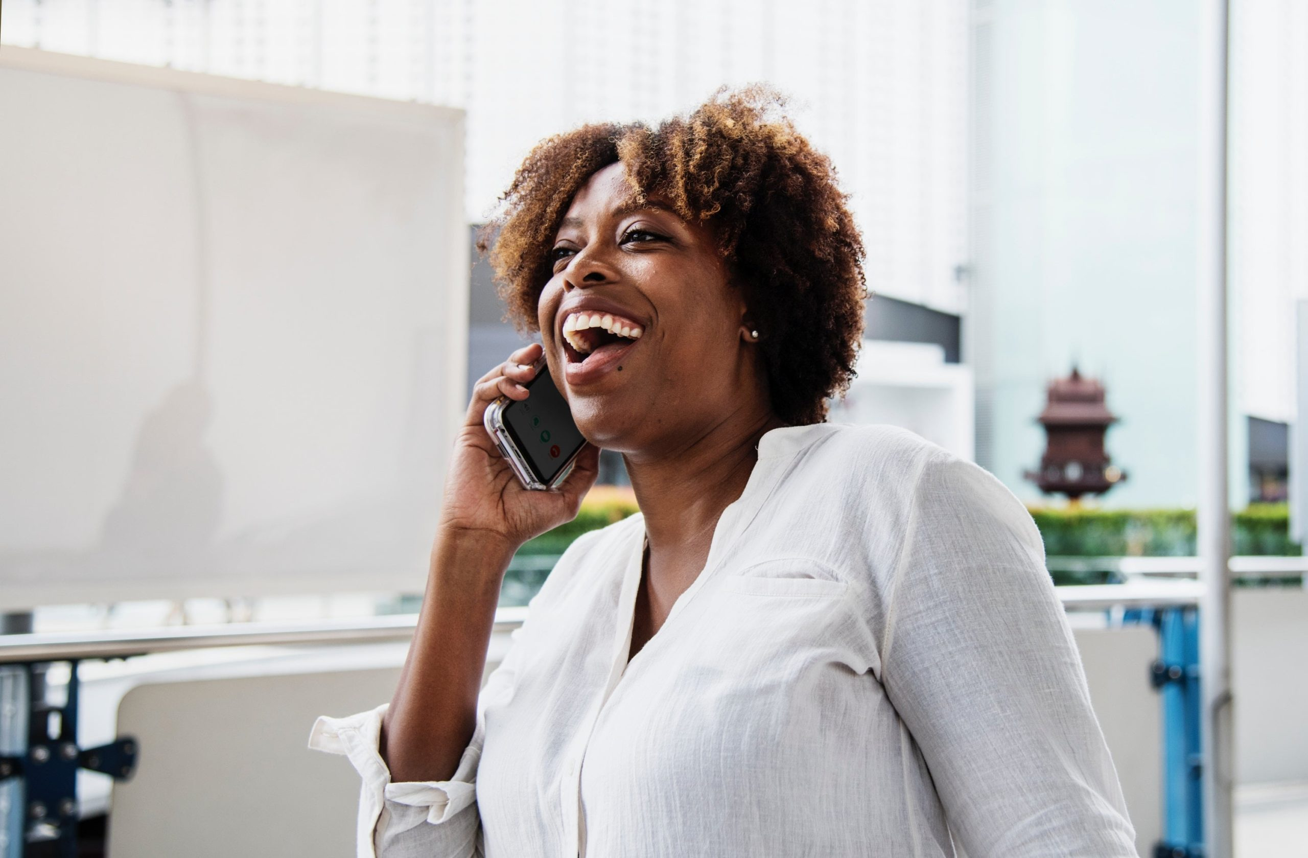 A happy person receiving a phone call.