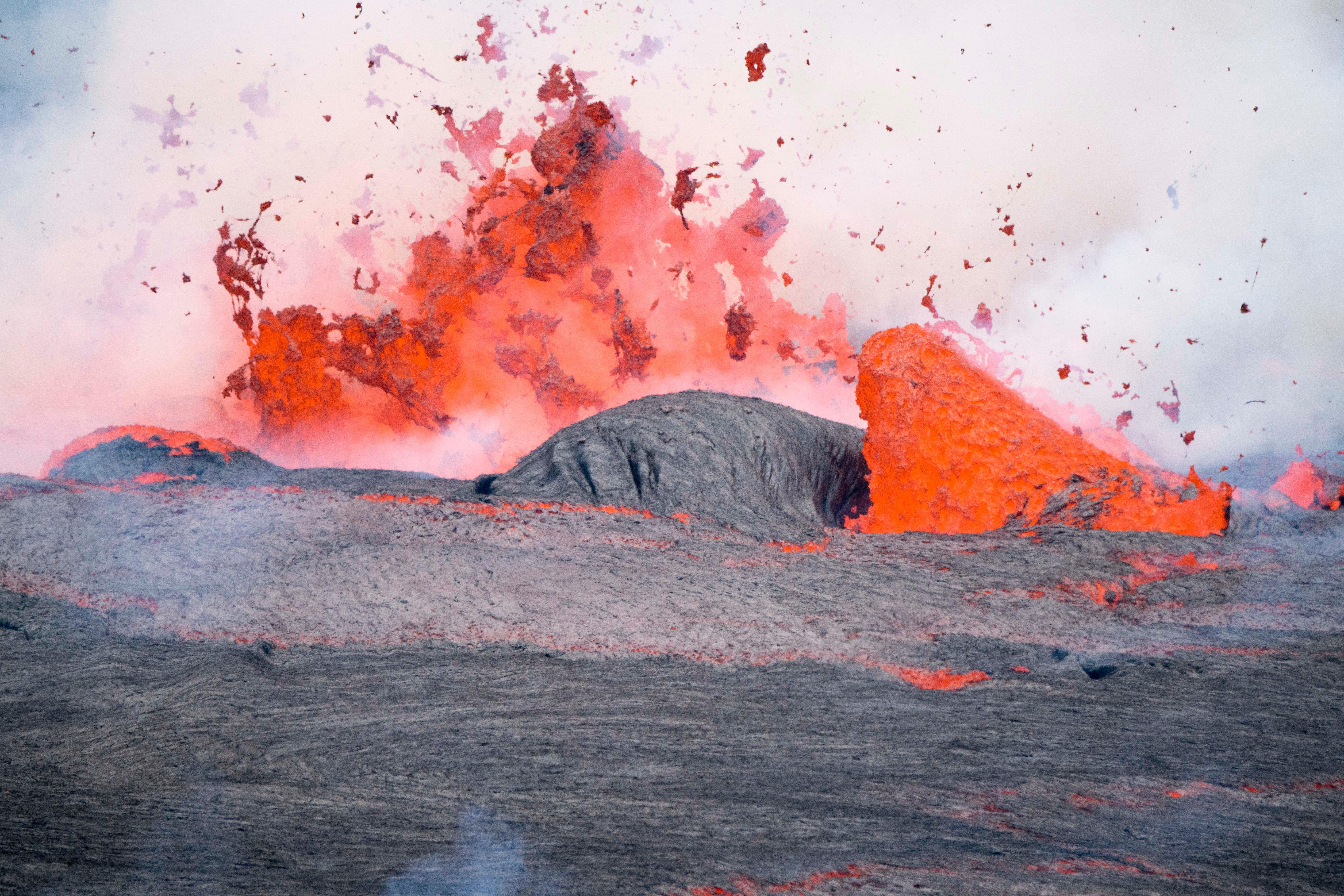 Lava splashing against a rock surface.