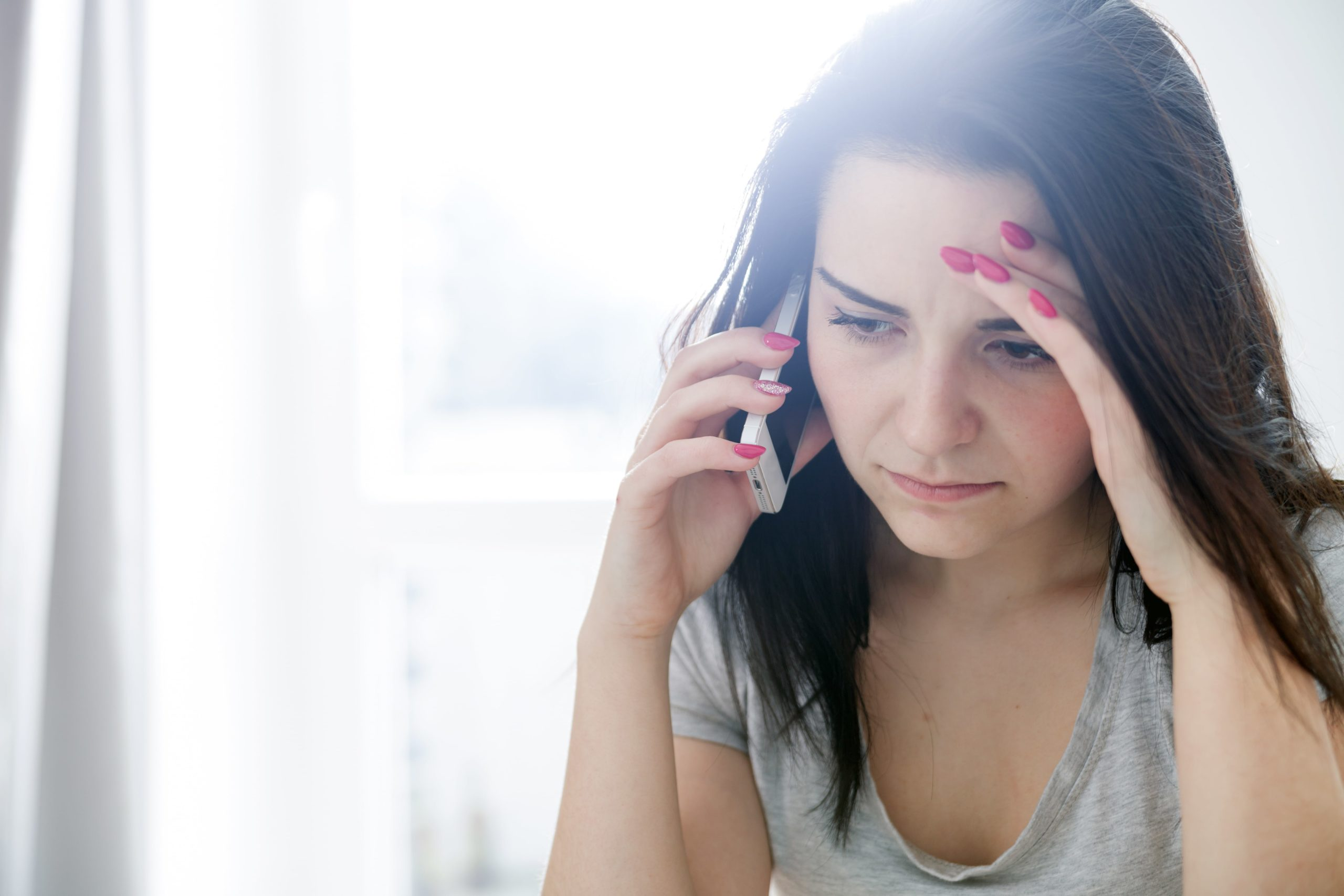 Woman dealing with a nuisance call.