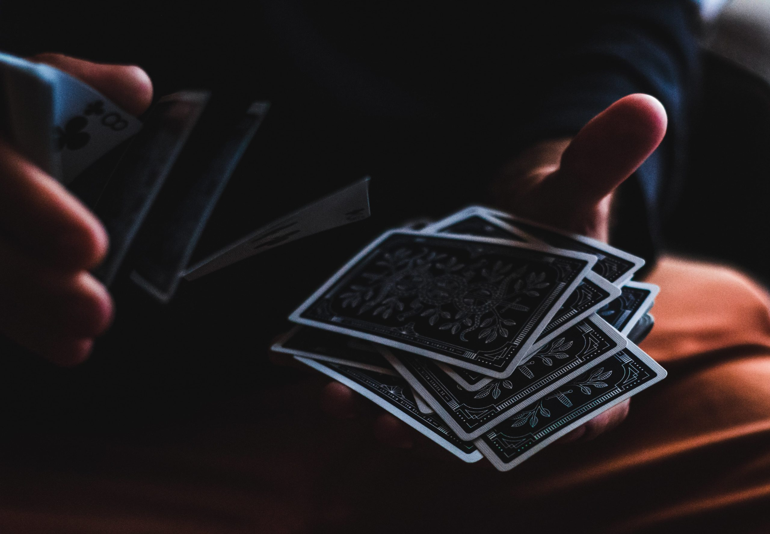 Person shuffling playing cards.