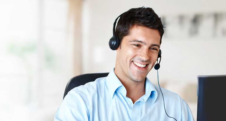 A contact centre employee working alone.